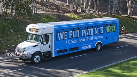 ROLLING OUT: A Hillcrest Shuttle featuring UCSD Health System advertisements leaves campus.  The advertising program is part of a campaign rolling out this quarter to reduce UCSD Transportationand Parking Services' department costs.  Ad revenue will put four new buses in service
