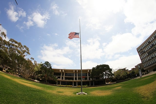 The flag in Revelle Plaza flew at half mast Monday to mourn the death of Revelle junior Ricardo Ambriz, at the request of Revelle College Provost Paul Yu. Photo by Jonathan Gao/Guardian