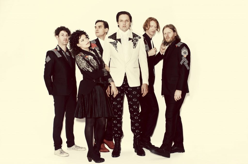 Arcade Fire (left to right: Jeremy Gara, Regine Chassagne, William Butler, Win Butler, Richard Reed Parry, Tim Kingsbury) photo used with permission from Guy Aroch via Nasty Little Man.