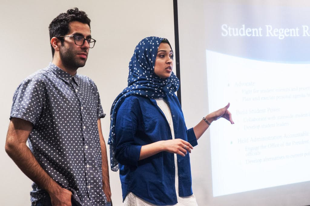 Avid Oved (left) and Sadia Saifuddin (right) present about the Student Regent application process. Photo by Taylor Sanderson.
