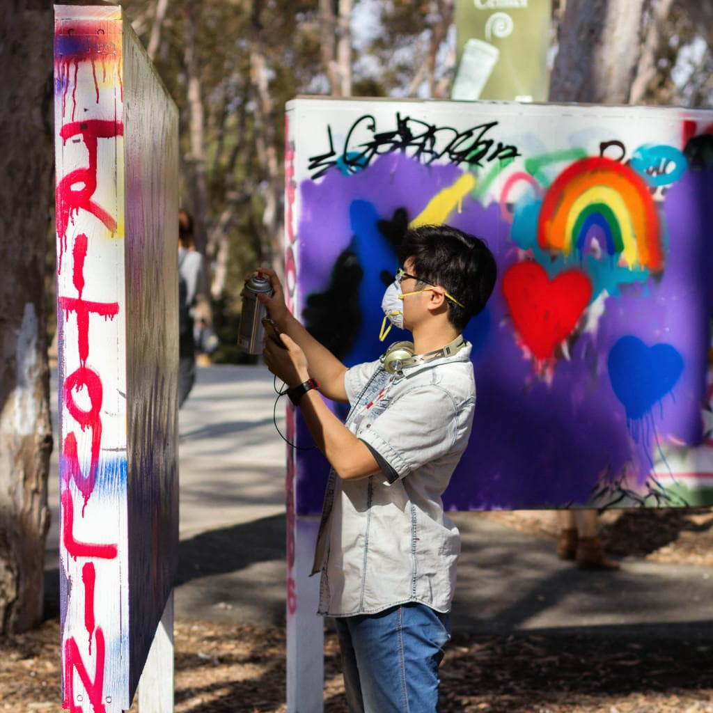 Students celebrated the LGBT Resource Center's 15th anniversary at the Graffiti Art Park by painting and spreading awareness. Photo by Emma Zilber/UCSD Guardian.