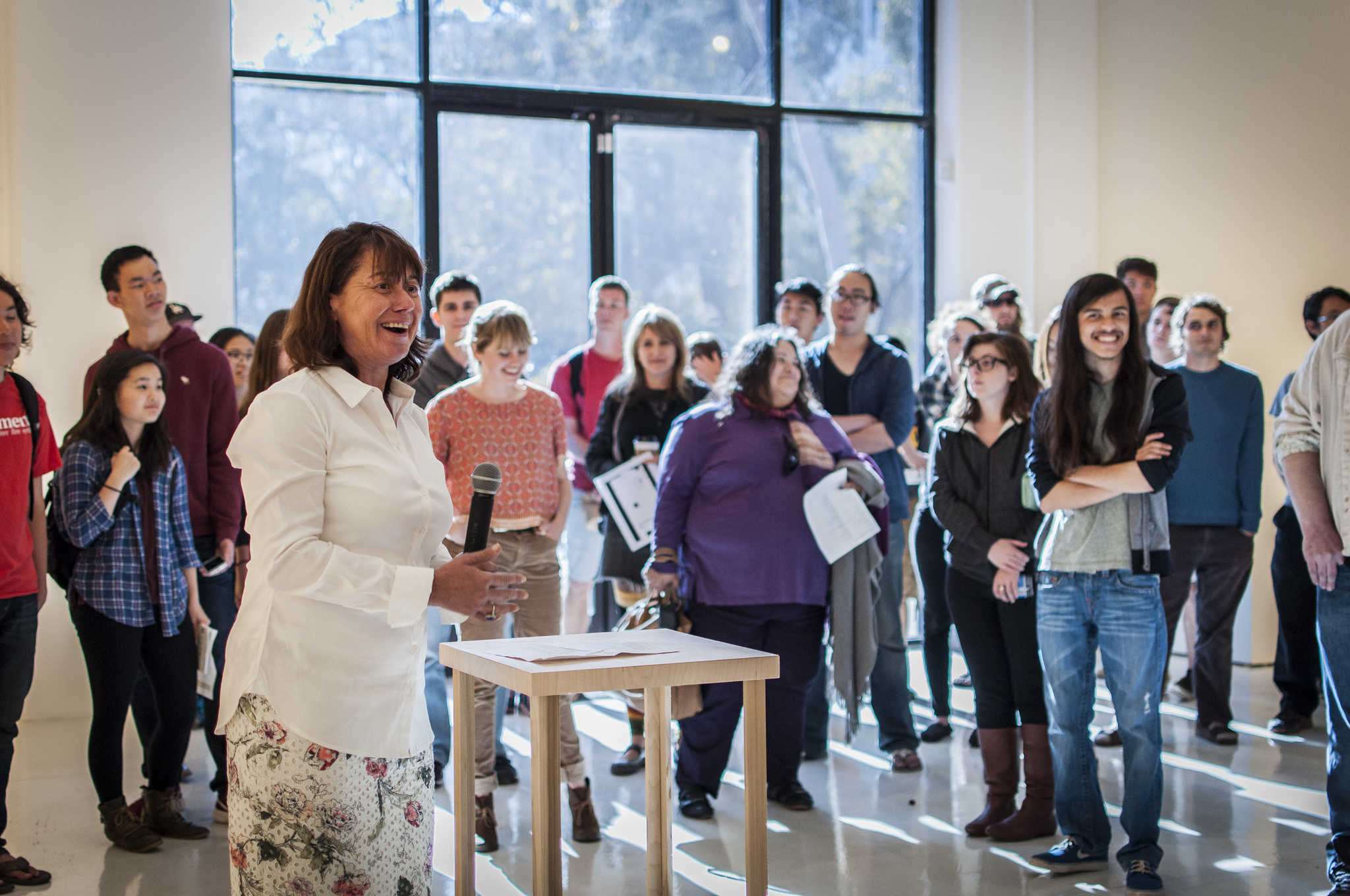 "Dean of Arts and Humanities Cristina Della Colletta addresses students during the ""Round But Square"" exhibit opening reception last Wednesday. Photo by Siddharth Atre/Guardian."