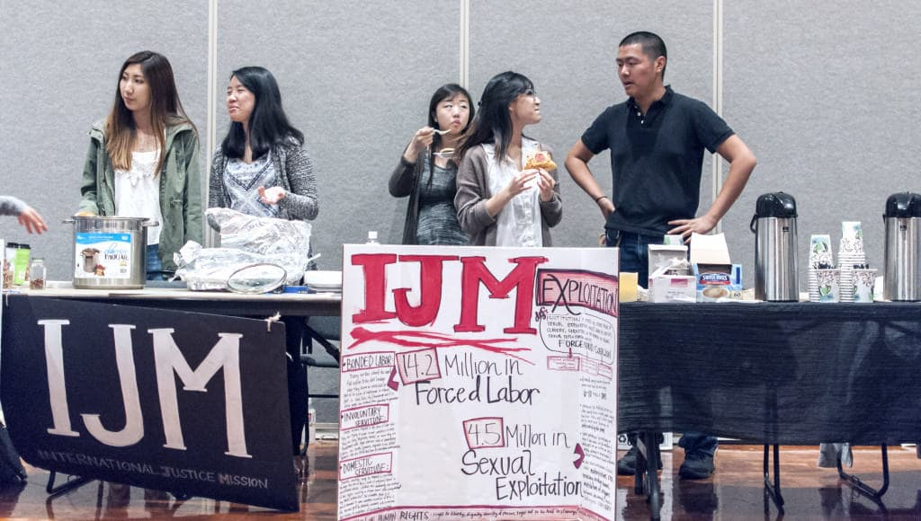 Representatives from International Justice Mission table at UCSD's second annual Social Justice Cafe Night earlier this week. Photo by Siddharth Atre / UCSD Guardian.