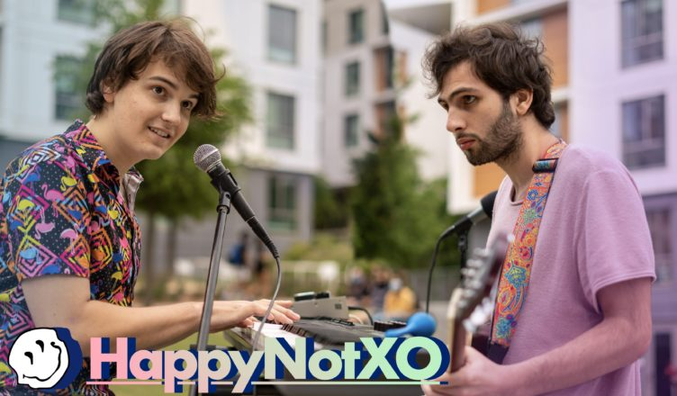 """Pictured left to right: Frontmen of """"HappynoT"""" Cameron Thomas and Karim Moussa perform at the band's Weekly Open-Mic at Sixth College. Photo Credit to Alexander Olsen (@alexanderthefriendly) and UCSD Guardian."""